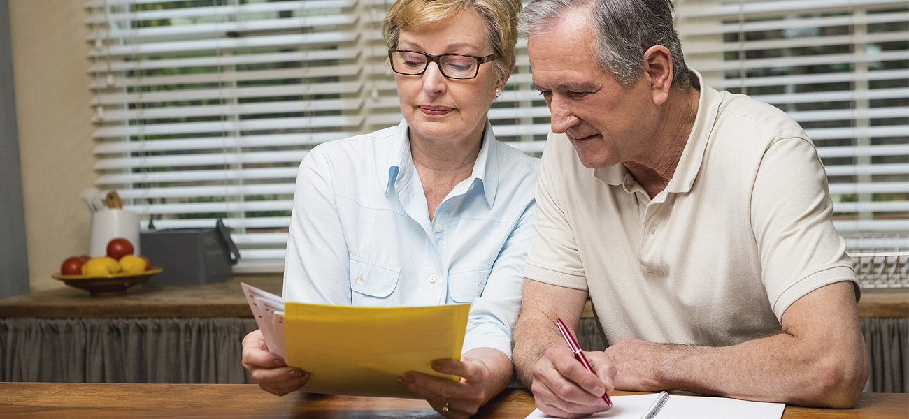 image of a couple organizing medical records